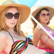 Girls sunbathing on the beach — Stockfoto