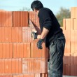 Stock Photo: Builder laying blocks