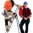 Plumber and an electrician - Stock Photo