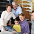Stock Photo: Family gathered in front room