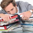 Stock Photo: Mdrowning in stacks of paperwork