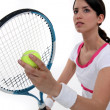 Tennis player about to serve - Foto Stock