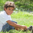 Child sitting in field — Stock Photo #10974611