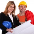 Tradesman conferring with an engineer — Stock Photo