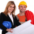 Stock Photo: Tradesmconferring with engineer