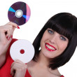 Stock Photo: Womholding digital storage discs