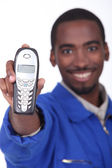 Technician showing landline phone — Stock Photo
