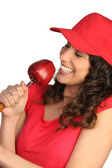 Woman eating a red apple — Stock Photo
