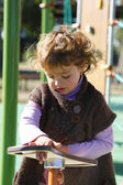 Young girl playing in a playground — Stock Photo