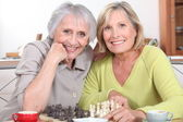 Mature women playing chess — Stock Photo