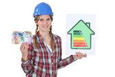 Mujer con signos de consumo de energía y billetes de banco — Foto de Stock