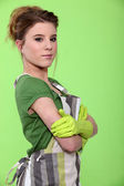 Portrait of a housewife wearing rubber gloves and an apron — Stock Photo