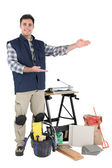 Proud tradesman showing off his tools — Stock Photo