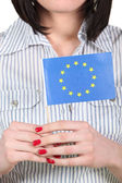 Woman holding an EU flag — Stock Photo