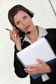 Call-center agent holding folder — Stock Photo