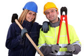 Male and female manual workers — Stock Photo