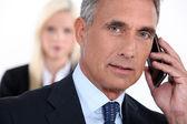 Senior businessman on white background — Stock Photo