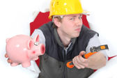 Builder with hammer and piggy-bank — Stock Photo