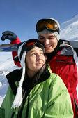 Boy and girl at ski resort — Stock Photo