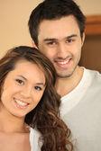 Portrait of smiling couple — Stock Photo