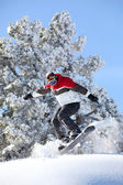 Man performing jump on snowboard — Stock Photo