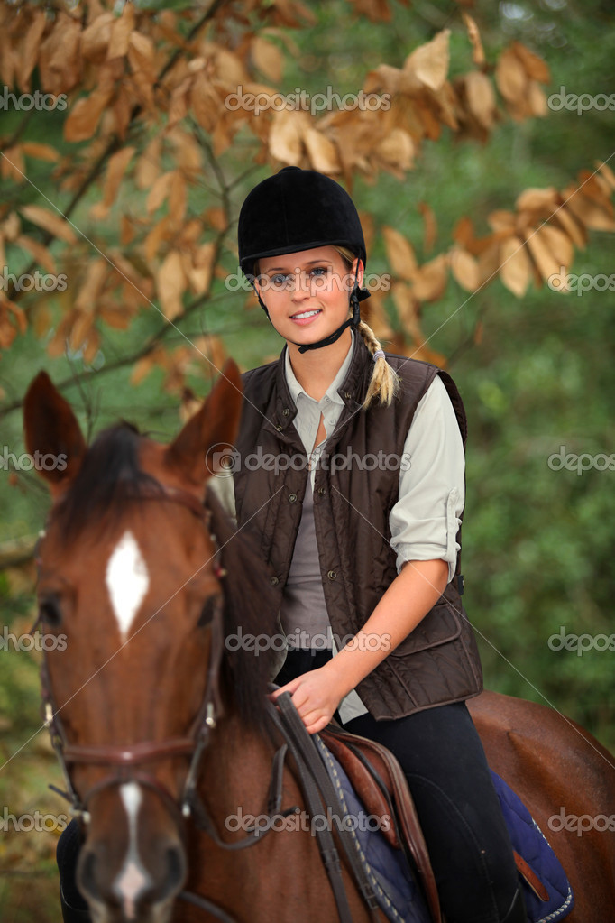 Young girl riding a horse — Stock Photo #10971686