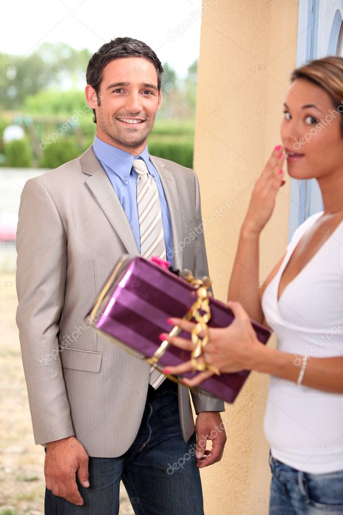 Woman receiving gift — Stock Photo #10974797
