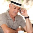 Hat man with phone — Stock Photo #11015861