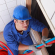 Plumber pulling on pipes — Stock Photo #11016294