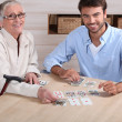 Young playing cards with senior woman — Stock Photo #11016350