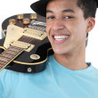 Mixed race teenager with electric guitar - Stock Photo