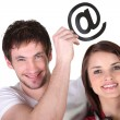 Couple with email symbol — Stock Photo
