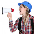 Woman laborer screaming in a bullhorn - Stockfoto