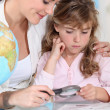 Stock Photo: Mother teaching little girl