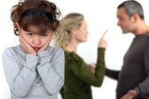 Cute little girl distressed over parents' quarrel — Stock Photo