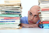 Bald office worker swamped with work — Stock Photo