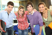 Students stood together in class — Stockfoto