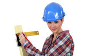 Craftswoman taking measurements — Stock Photo