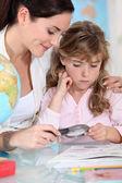 Mother teaching little girl — Stock Photo