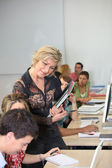 Teacher with a group of mature students — Stockfoto
