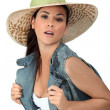 Flirtatious brunette wearing hat - Stock Photo