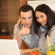 Stock Photo: Couple in kitchen