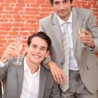 Two men toasting with champagne — Stock Photo