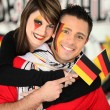 Man and woman supporting German football team — Stock Photo