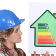 Stock Photo: Female housebuilder with energy rating sign