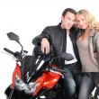 Biker couple with heads together. — Stock Photo #11021142