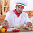Italian cook cooking - Stock Photo