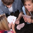 Teen playing cards — Stockfoto