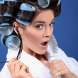 Stock Photo: Womwith curlers wearing sunglasses