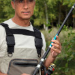 Stock Photo: Mwith fishing rod